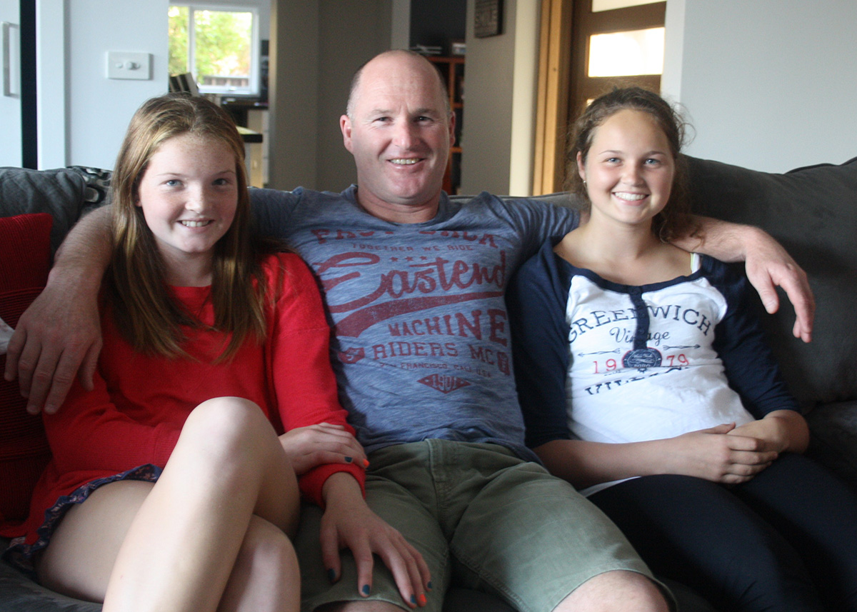 Anthony Banik and his daughters, Georgie and Jess.