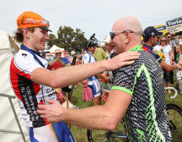 Zak Dempster celebrates with his father Darren, the D Grade winner. (Courtesy The Standard).