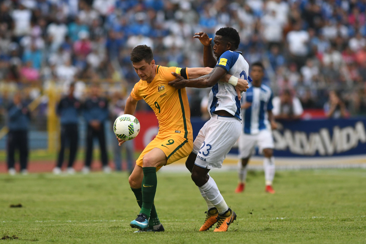 Australia's Tomi Juric (L) and Honduras' Johnny Palacios vie for the bal. Pic: ORLANDO SIERRA/AFP/Getty Images)