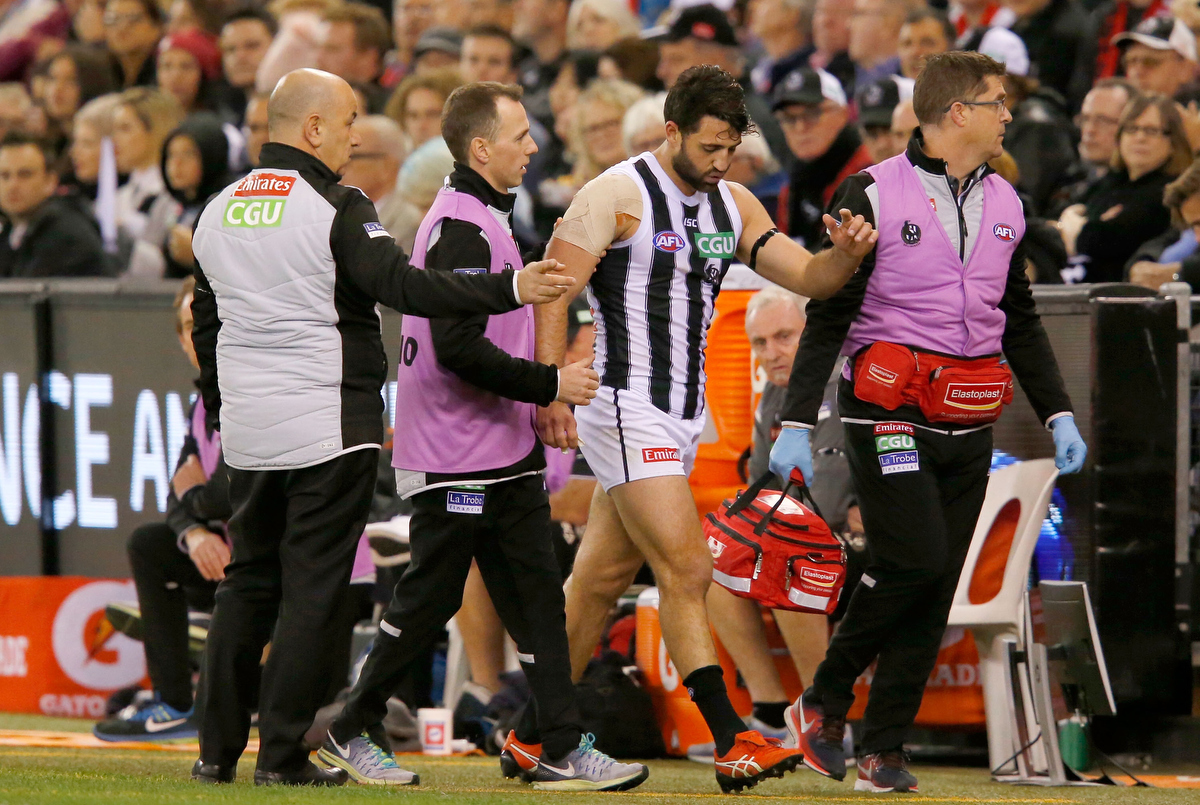 Alex Fasolo heads to the rooms for treatment after injuring his ankle. pic: Darrian Traynor/AFL Media/Getty Images
