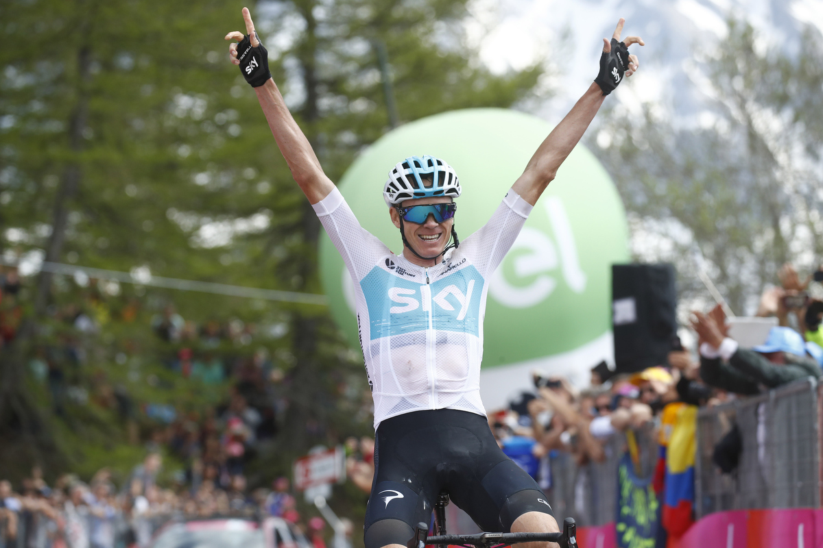 Christopher Froome crosses the finish line and wins the 19th stage. Pic:  LUK BENIES/AFP/Getty Images